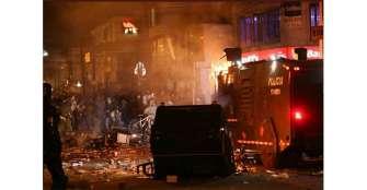 Disturbios en varias ciudades en protesta contra violencia policial en Bogotá